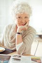 Happy senior woman looking at you portrait of a with hand on chin Stock Photography