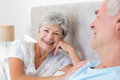 Happy senior woman with man in bed portrait of women men at home Royalty Free Stock Images