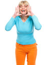 Happy senior woman shouting Royalty Free Stock Photos