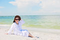Happy senior woman a smiling in a sun hat and sunglasses on beach Royalty Free Stock Photo