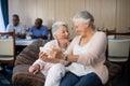 Happy senior woman taking selfie through mobile phone Royalty Free Stock Photo