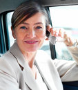 Happy senior woman talking on mobile phone in car Royalty Free Stock Photo