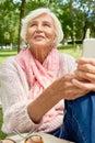 Happy Senior Woman Using Smartphone
