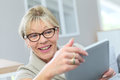 Happy senior woman using tablet Royalty Free Stock Photo