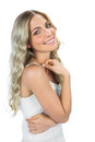 Happy sensual blond woman smiling on white background Royalty Free Stock Photo