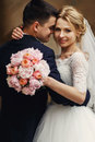 Happy sensual handsome groom and blonde beautiful bride in white Royalty Free Stock Photo