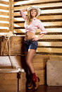 A happy and sexy cowgirl in a barn Royalty Free Stock Photo