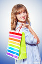 Happy shopaholic returning with her purchases Stock Images