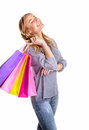 Happy shopper girl with closed eyes isolated on white background enjoying shopping sales season making purchase spending money Royalty Free Stock Photo