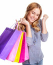 Happy shopper girl closed her eyes with pleasure and holding in hand colorful shopping bags isolated on white background Royalty Free Stock Photo