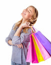 Happy shopper girl portrait of with closed eyes isolated on white background enjoying shopping sales season making purchase Stock Photos