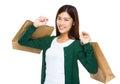 Happy shopper holding shopping bag Royalty Free Stock Photo
