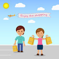Happy shoppers in the parking lot at the store Royalty Free Stock Images