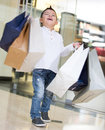 Happy shopping boy holding bags smiling Royalty Free Stock Photography