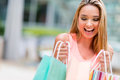 Happy shopping girl portrait of a looking at bags Royalty Free Stock Photos