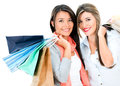 Happy shopping girls holding bags isolated over white background Stock Images
