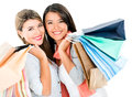 Happy shopping girls holding bags and smiling isolated over white Royalty Free Stock Image