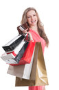 Happy shopping lady holding bags card and wallet smiling on white background Stock Photo