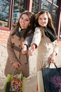 Happy Shopping: Two Women with bags Royalty Free Stock Photos