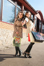 Happy Shopping: Two Women with bags Stock Image