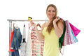 Happy shopping woman beautiful female shopper with bags credit card and clothes on hangers on a white background Stock Photo