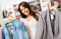 Happy shopping woman buying clothes store Stock Image