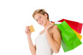 Happy shopping woman with credit card and shopping bags on white background Stock Image