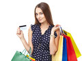 Happy shopping woman with credit portrait of young beautiful smiling card and many colorful bags isolated on white background Royalty Free Stock Image