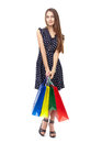 Happy shopping woman full length portrait of young beautiful smiling holding many colorful bags isolated on white background Stock Images