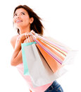 Happy shopping woman holding bags isolated over a white background Stock Photography