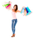 Happy shopping woman holding bags isolated over a white background Royalty Free Stock Images