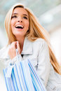 Happy shopping woman at the mall holding bags Royalty Free Stock Images