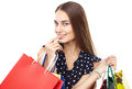 Happy shopping woman portrait of young beautiful smiling with many colorful bags with finger on lips isolated on white background Royalty Free Stock Photography