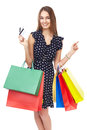 Happy shopping woman portrait of young beautiful smiling with two credit cards and many colorful bags pointing finger isolated on Stock Photo