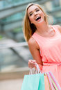 Happy shopping woman very at the mall holding bags Royalty Free Stock Image