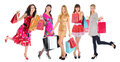 Happy shopping women beautiful young in a full length with bags isolated on white background Royalty Free Stock Photography