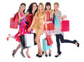 Happy shopping women beautiful young in a full length with bags isolated on white background Stock Image