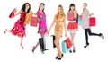 Happy shopping women beautiful young in a full length with bags isolated on white background Royalty Free Stock Photo