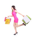 Happy shopping young woman running with color bags isolated on white background full body asian model Royalty Free Stock Photography