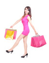 Happy shopping young woman running with color bags isolated on white background full body asian model Stock Photography