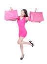 Happy shopping young woman running with color bags isolated on white background full body asian model Royalty Free Stock Image