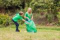 Happy siblings collecting rubbish on a sunny day Royalty Free Stock Photos