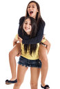 Happy sisters on piggyback Royalty Free Stock Photo