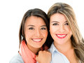Happy sisters portrait of two isolated over a white background Stock Images