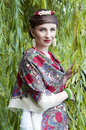 Happy slavonic woman near the willow tree smiling Royalty Free Stock Photo