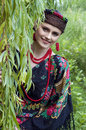 Happy slavonic woman near the willow tree smiling Stock Photography
