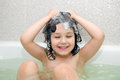 Happy small child bathing in bathtub Royalty Free Stock Photo
