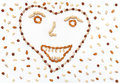 Happy smile, composition of tropical nuts. Royalty Free Stock Photo