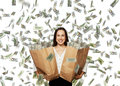 Happy and smiley businesswoman holding paper bag looking at camera under dollar s rain Stock Photography