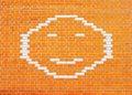 Happy Smiley Face on orange brick wall